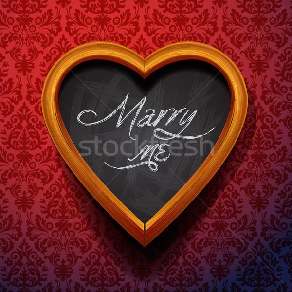 Stock photo: Marry Me written by chalk on heart shaped board