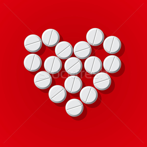 Pills in heart arrange on red background Stock photo © ikopylov