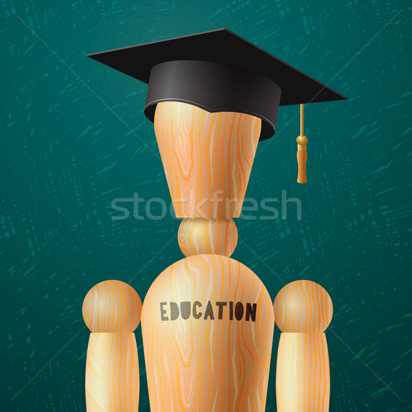 Education design, wooden dummy in the mortarboard Stock photo © ikopylov
