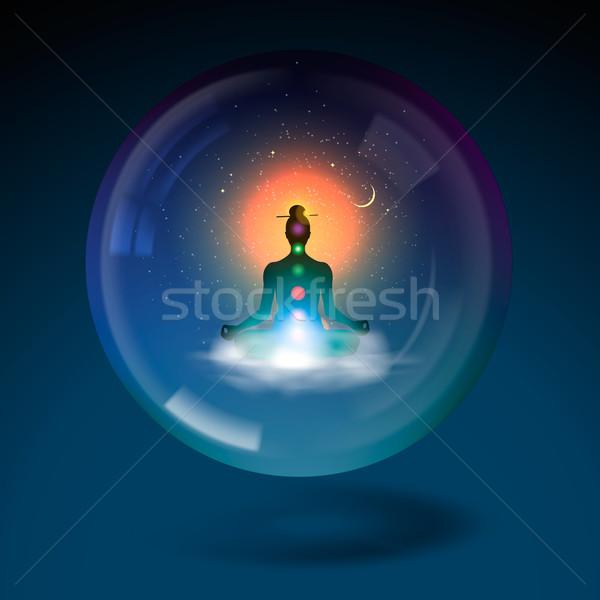 Meditating silhouette sitting lotus position in sphere. Stock photo © ikopylov