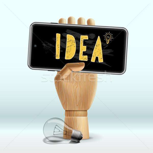 Pomysł ludzka ręka telefonu komórkowego działalności projektu Zdjęcia stock © ikopylov