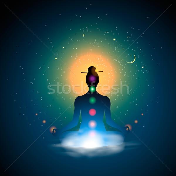 Meditating silhouette sitting in lotus position? Stock photo © ikopylov