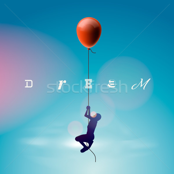 Silhouette of the man flying by a balloon Stock photo © ikopylov