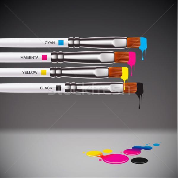 CMYK brushes on grey background Stock photo © ikopylov