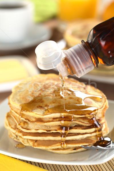Pouring Maple Syrup on Pancakes Stock photo © ildi