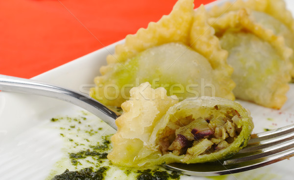 Empanada Filled with Meat on Fork Stock photo © ildi
