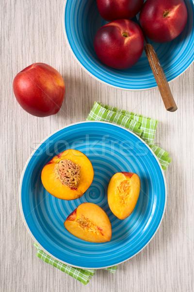 Friss érett nektarin gyümölcs vág darabok Stock fotó © ildi