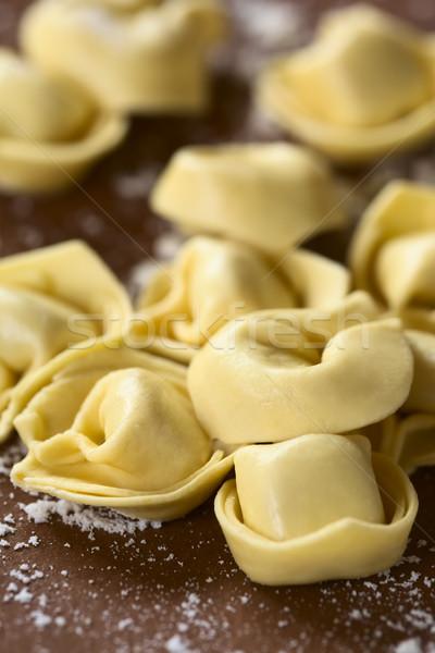Crudo tortellini queso pasta superficie la luz natural Foto stock © ildi