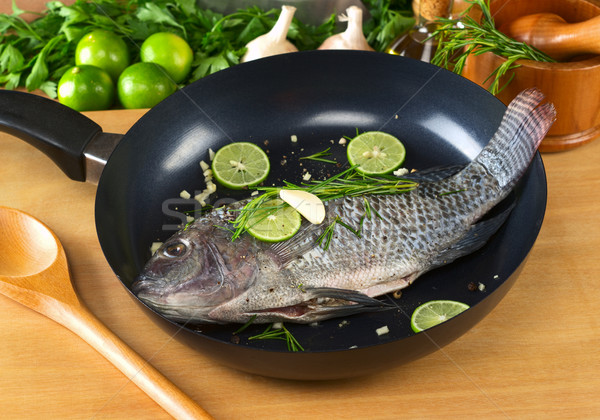 Raw Tilapia with Condiments in Frying Pan Stock photo © ildi