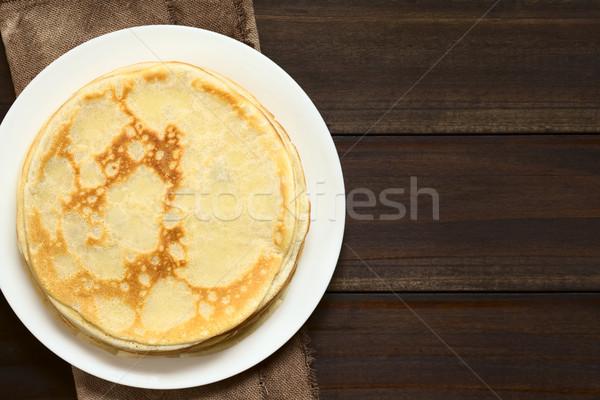 Boglya frissen egymásra pakolva tányér sötét fa Stock fotó © ildi