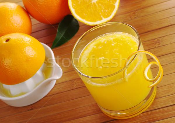 świeże sok pomarańczowy pomarańczowy plasterka szkła pomarańcze tabeli Zdjęcia stock © ildi