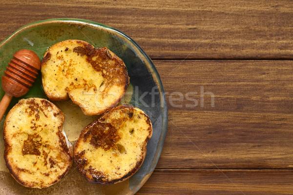 Francés brindis miel baguette lado oscuro Foto stock © ildi