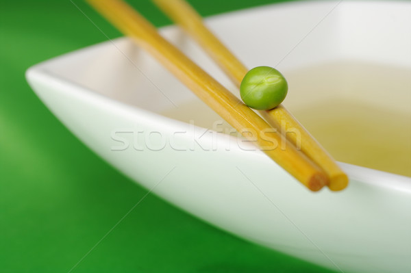 Chinese Diet: Vegetable Broth with One Pea Stock photo © ildi