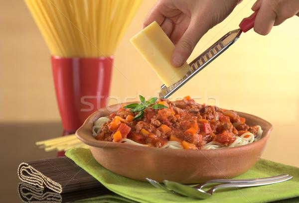 Grating Cheese over Spaghetti Bolognaise Stock photo © ildi