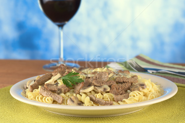 Veal Strips with Mushrooms on Pasta Stock photo © ildi