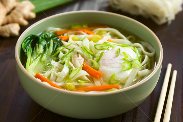 Asian Rice Noodle Soup with Vegetables and Poached Egg Stock photo © ildi