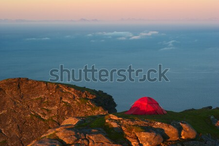 Tent on a Mountain Ridge Lit by the Midnight Sun Stock photo © ildi