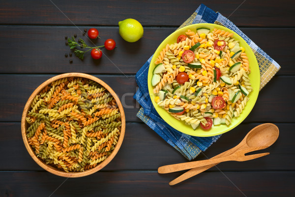 Stock photo: Raw Fusilli and Vegetarian Pasta Salad