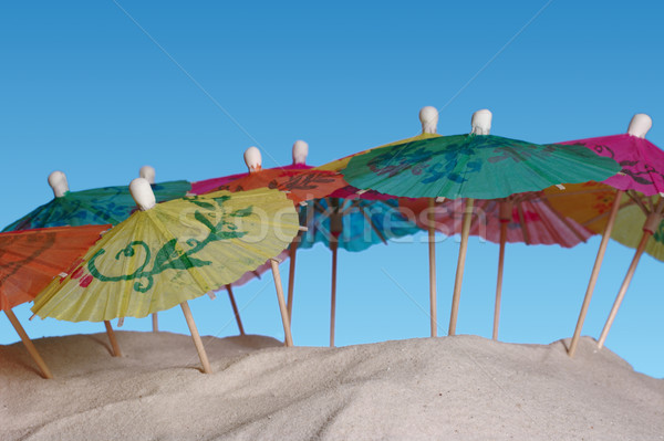 Sunshades on Sand Stock photo © ildi