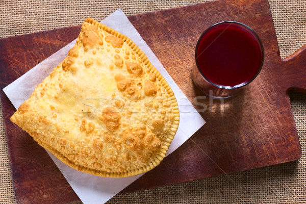 Pastel, a Bolivian Snack with Api, a Purple Corn Beverage Stock photo © ildi