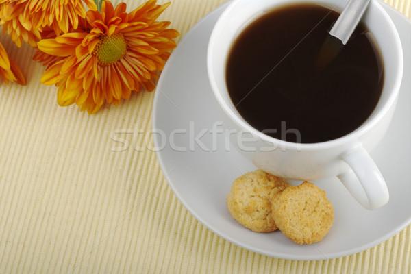 Narancs virágok felső csésze csészealj teáskanál Stock fotó © ildi