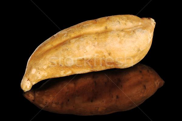 Sweet Potato on black Stock photo © ildi
