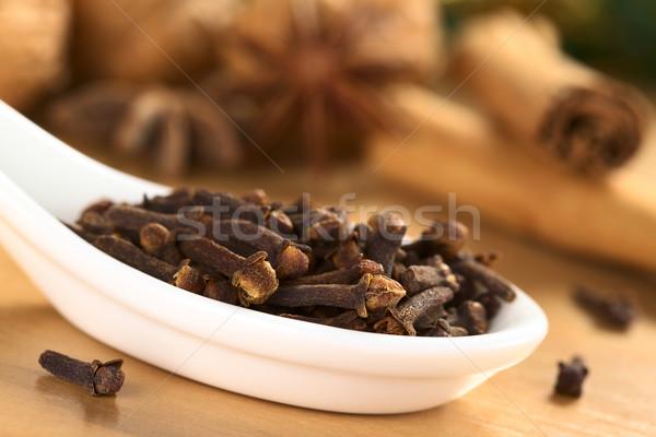 Сток-фото: гвоздика · керамической · ложку · анис · корицей · орехи