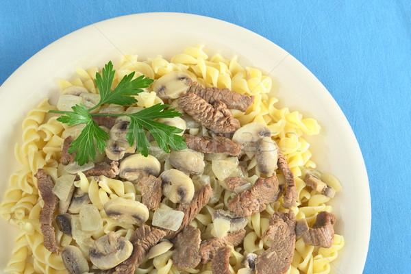 Veal Strips with Mushrooms on Pasta Stock photo © ildi