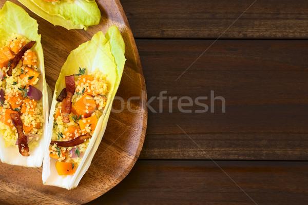 Pumpkin and Couscous Salad on Endive Leaves Stock photo © ildi