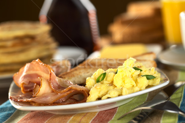 Stock photo: Fried Bacon and Scrambled Egg