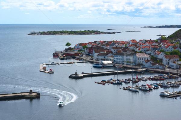 Motorboat Entering the Harbor of Risor, Norway Stock photo © ildi