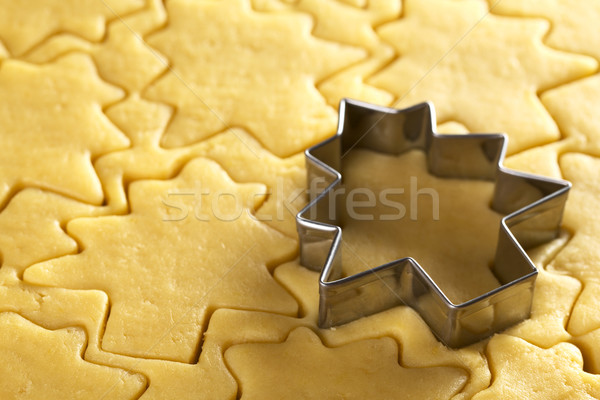 Cutting Out Christmas Cookies Stock photo © ildi