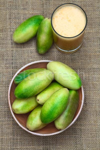 Banana Passionfruit (lat. Passiflora Tripartita) and Juice Stock photo © ildi