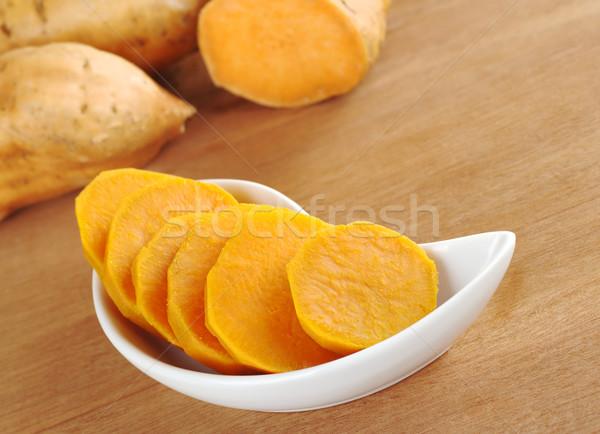 Cooked Sweet Potato Slices in White Bowl Stock photo © ildi
