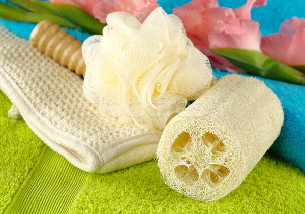 Towels with Bath Spa Kit and Gladiolus Stock photo © ildi