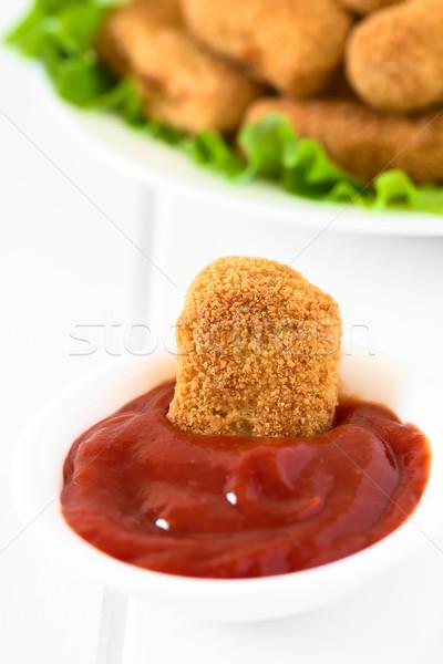 Pollo ketchup croccante la luce naturale messa a fuoco selettiva Foto d'archivio © ildi