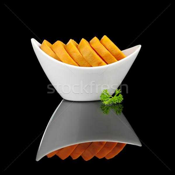 Cooked Sweet Potato with Parsley on Black Stock photo © ildi