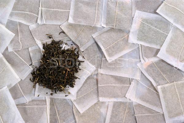 Teabags with green tea pile Stock photo © ildi