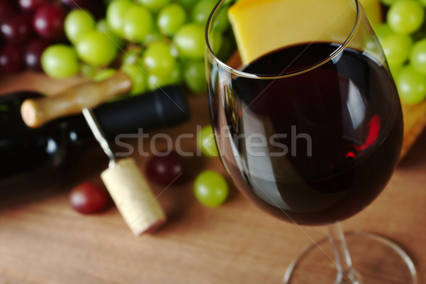 Stock photo: Red Wine with Grapes and Cheese