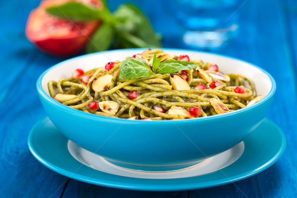 Spaghetti with Pesto, Pomegranate and Almonds Stock photo © ildi