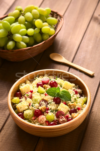 Cuscús uvas granada nueces queso vegetariano Foto stock © ildi