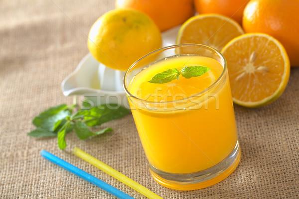 świeże sok pomarańczowy pomarańczowy plasterka mięty liści Zdjęcia stock © ildi