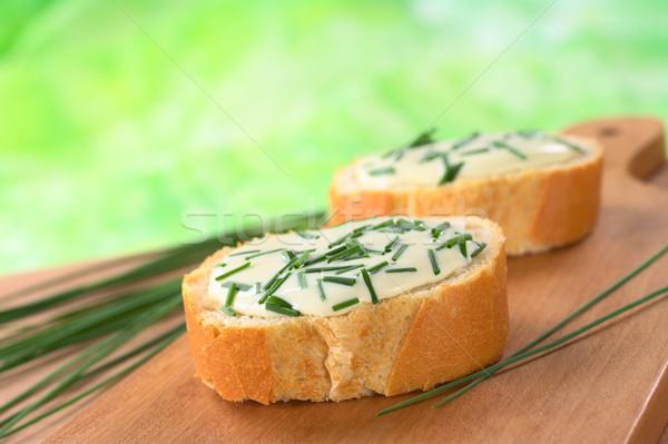 Soft formaggio erba cipollina fette tagliere Foto d'archivio © ildi