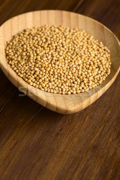 Geel mosterd zaden klein houten plaat Stockfoto © ildi