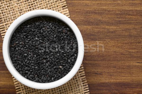 Negro pequeño tazón la luz natural atención selectiva Foto stock © ildi