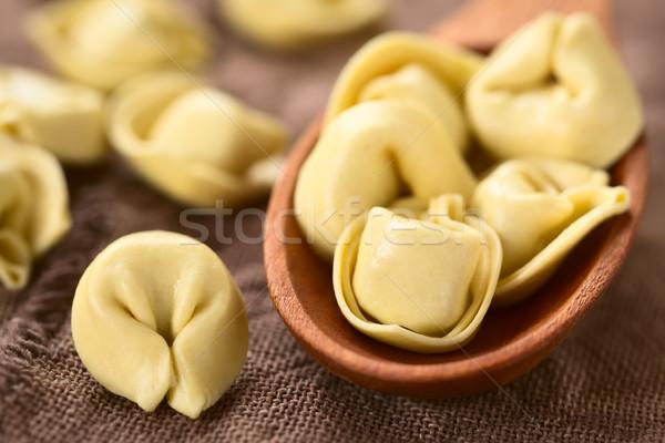 Nyers tortellini sajt tészta fakanál természetes fény Stock fotó © ildi