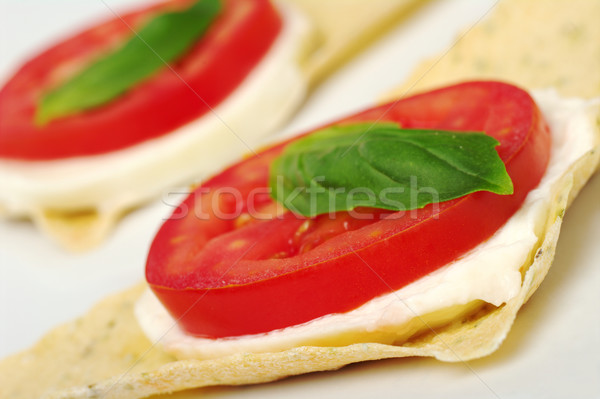 Appetizer: Tomato, Mozzarella and Basil on Crocantini Stock photo © ildi