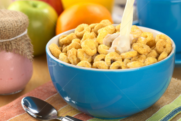 Pouring Milk Over Honey Flavored Cereal Loops Stock photo © ildi