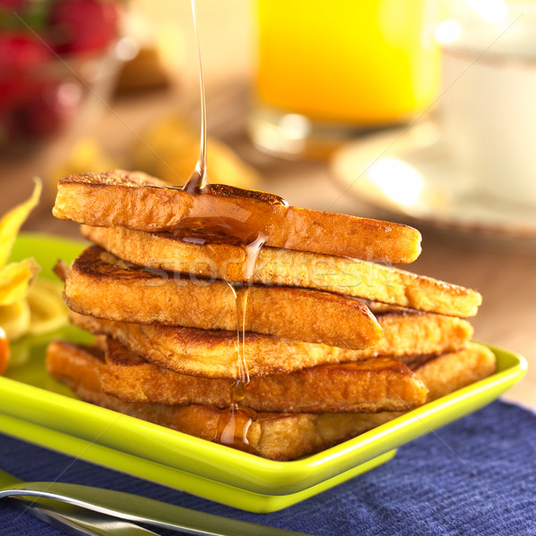 Pouring Maple Syrup on French Toast Stock photo © ildi