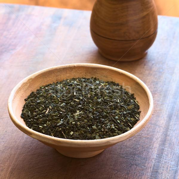Aszalt zöld tea levelek tál tea fából készült Stock fotó © ildi